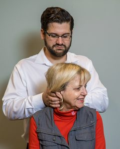 Manual chiropractic adjustment at Summit Family Chiropractic in Mount Juliet, TN